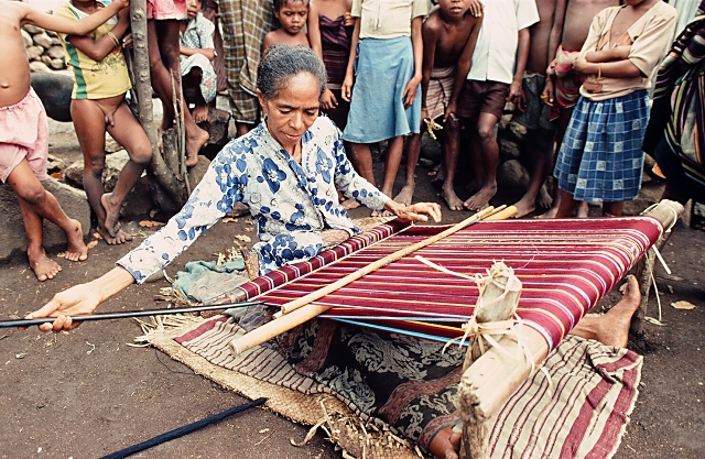 Woman weaving ikat sarong on Alor